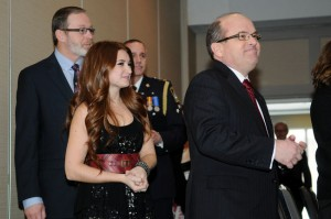 Singer-songwriter Tenille Nadkrynechny enters the room, following GPRC president and CEO Don Gnatiuk at the GP Inn. Tenille and 22 others were awarded with the Queen Diamond Jubilee medal by Lt.-Gov. Donald S Ethel during a ceremony Friday. (Adam Jackson/Daily Herald-Tribune)